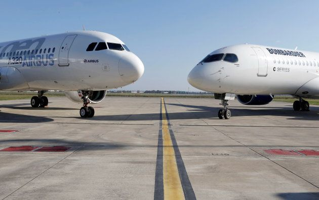 An Airbus A320neo aircraft and a Bombardier CSeries aircraft are pictured during a news conference to...