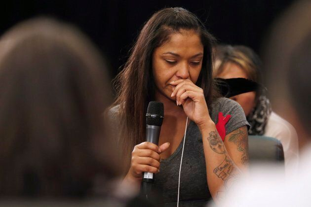 A woman weeps as she speaks of her murdered cousin at a hearing for the National Inquiry into Missing...
