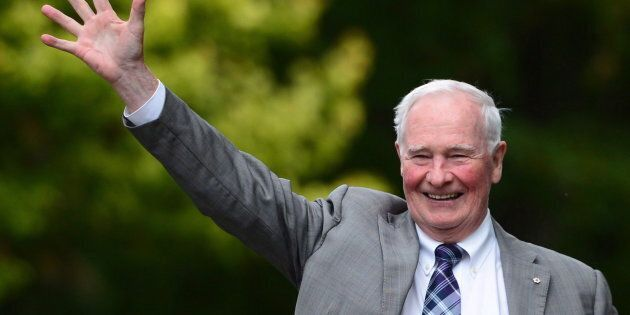 Governor General David Johnston waves as he leaves following a ceremonial tree planting to commemorate...