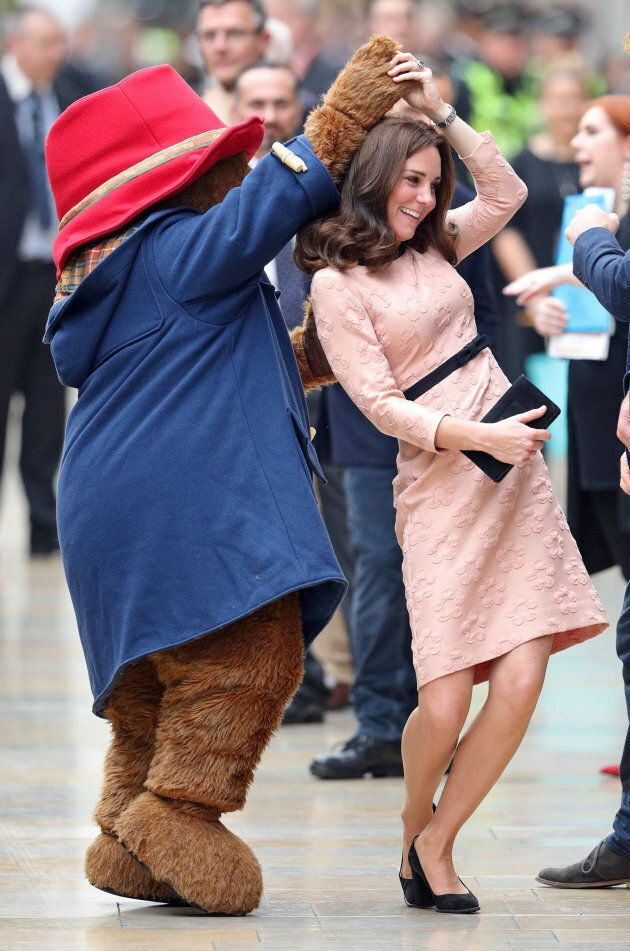 Catherine, Duchess of Cambridge dances with Paddington Bear as she attends the Charities Forum Event...