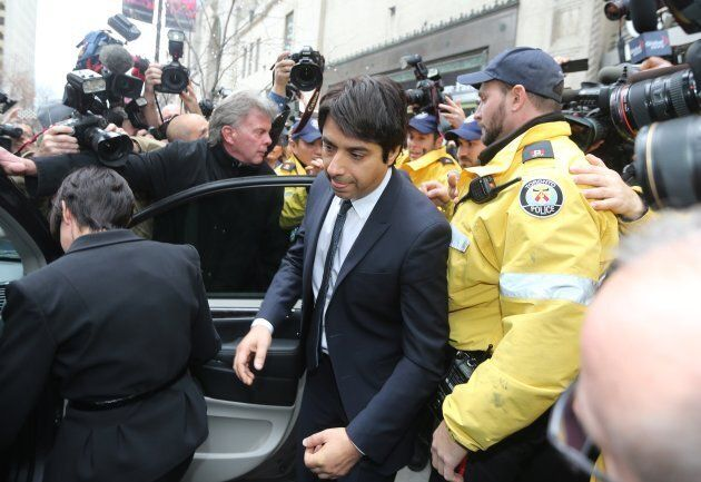 Jian Ghomeshi leaving College Park Court with his lawyer, Marie Henein, after Ghomeshi was released on $100,000 bail.
