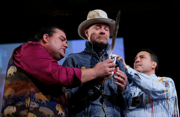 Gord Downie, centre, is honoured during the Assembly of First Nations Special Chiefs Assembly in Gatineau,...