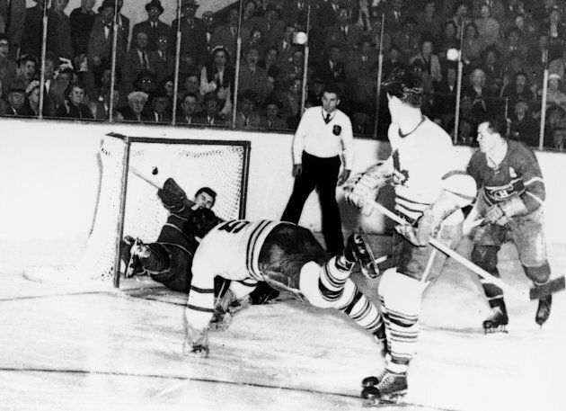 Bill Barilko (1927 - 1951) of the Toronto Maple Leafs scores the winning goal against the Montreal Canadiens...