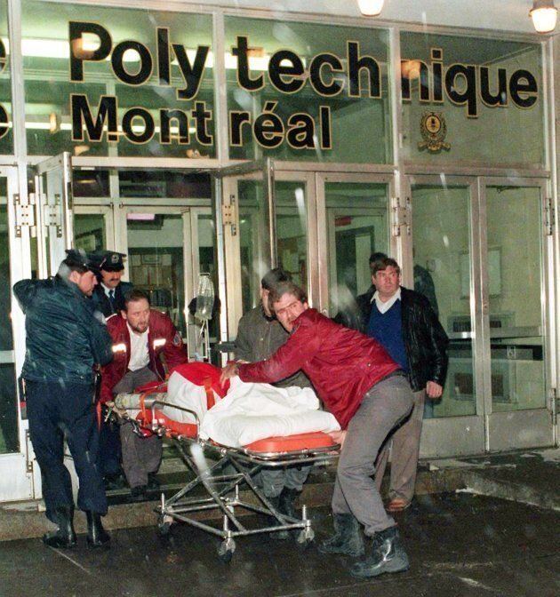 An injured person is wheeled away from the University of Montreal after a gunman, Marc Lepine, opened fire in a packed classroom in Montreal on Dec. 6, 1989.