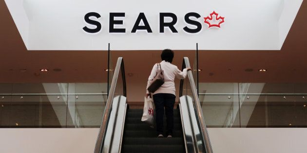 A woman takes an escalator to a Sears store in Mississauga, Ontario, Canada, October 6,