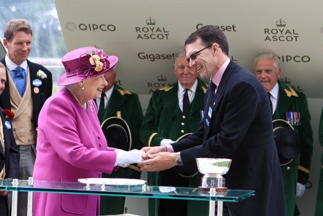 Trainer Aiden O'Brien shakes hands with Queen Elizabeth II after winning the Hardwicke Stakes with horse