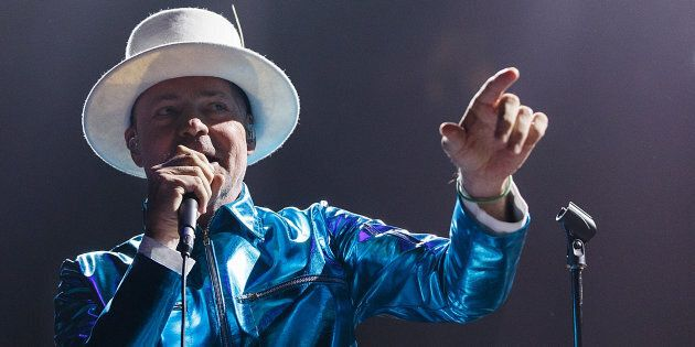 Gord Downie of The Tragically Hip performs onstage during their 'Man Machine Poem Tour' at Rogers Arena...