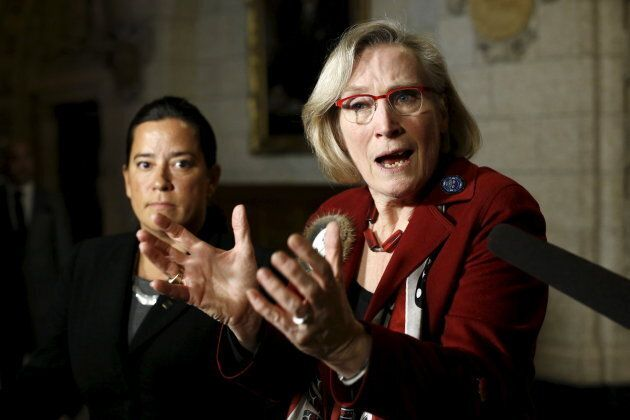 Canada's Indigenous Affairs Minister Carolyn Bennett, right, speaks during a news conference regarding a ruling by the Canadian Human Rights Tribunal with Justice Minister Jody Wilson-Raybould on Parliament Hill in Ottawa, Jan. 26, 2016.