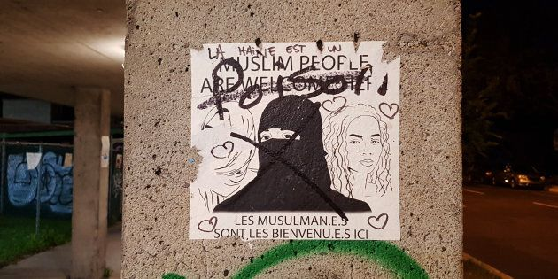 A defaced pro-refugee sign in Montreal.