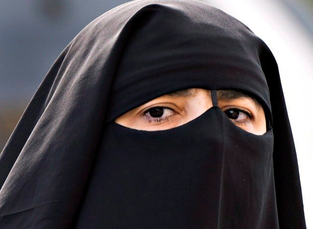 A woman wears a niqab as she walks in Montreal on Sept. 9,