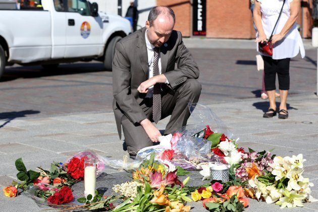 Kingston Mayor Bryan Paterson places flowers on The Tragically Hip commemorative plaque in Kingston,...