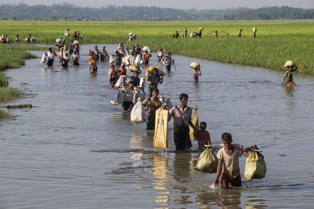 On Oct. 16, 2017, Rohingya refugees including women and children cross into Bangladesh at Palong Khali...