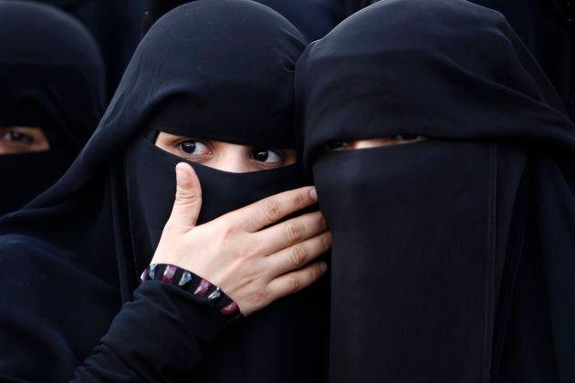 Two women wearing niqabs.