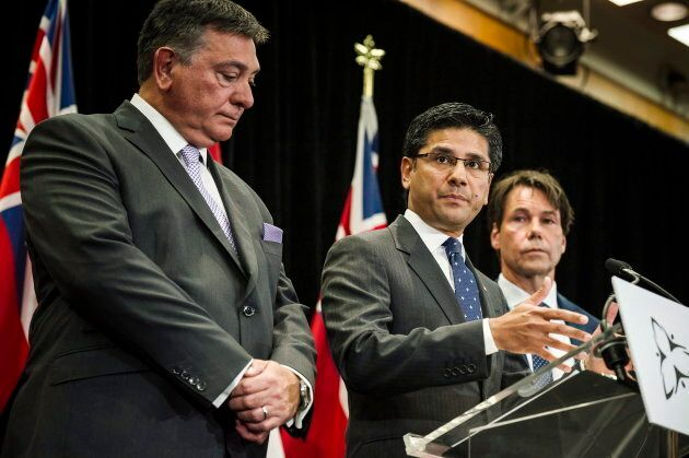 Attorney General Yasir Naqvi in between Minister of Finance Charles Sousa, left, and Minister of Health...