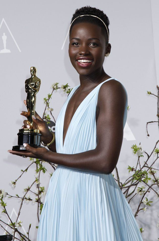 """Lupita Nyong'o holds her Oscar for Best Supporting Actress for her role in """"12 Years a Slave"""" at the 86th Academy Awards in Hollywood, California March 2, 2014."""