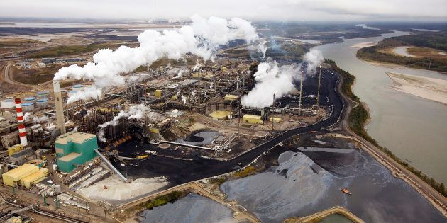 The Suncor oilsands processing plant on the Athabasca River near Fort McMurray, Alta., Sept. 17, 2014. With oil prices in a prolonged slump, Canada's oil firms are retrenching.