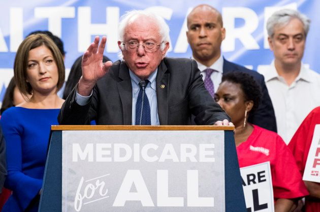 Dr. Danielle Martin (left) watches as Sen. Bernie Sanders speaks during his event to introduce the Medicare...