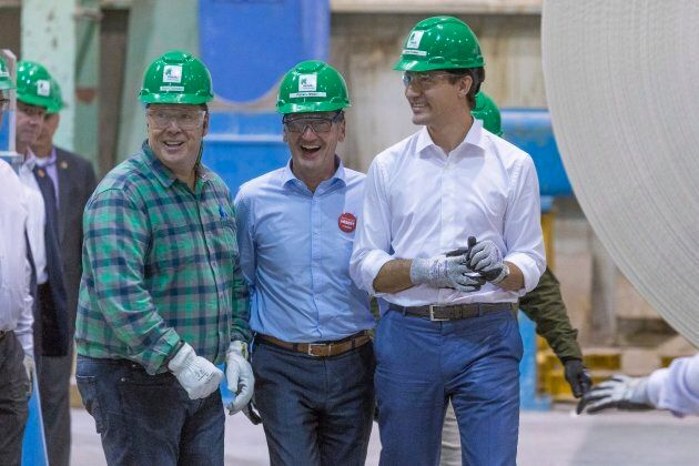 Prime Minister Justin Trudeau, right, visits the Resolute Forest Products plant with Richard Hebert,...