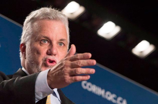 Quebec Premier Philippe Couillard shown speaking at a luncheon speech in Montreal on Oct. 13,