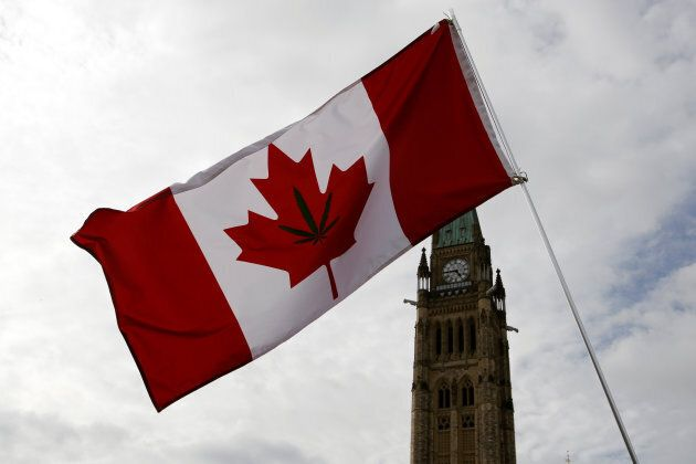 A Canadian flag with a marijuana leaf shown waving during the annual 4/20 marijuana rally on Parliament...