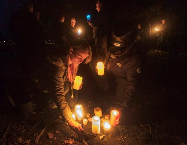 Fans of the Tragically Hip gather for a candlelight vigil by the water's edge in Bobcaygeon Ont. on Wednesday...