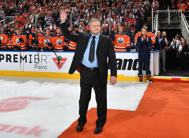 Edmonton Police Const. Mike Chernyk waving to the crowd before a game between the Edmonton Oilers and...