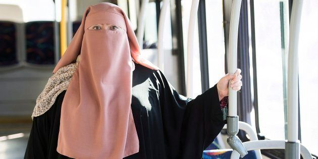 Warda Naili posing on a city bus in Montreal on October 21, 2017. She is worried about what will happen...