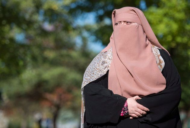 Warda Naili, who chooses to wear a niqab, in a park in Montreal on Oct. 21,