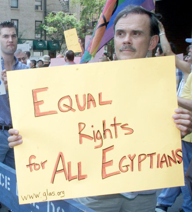 Protestors march near the Egyptian consulate in New York City on Aug. 15, 2001 carrying signs critical of the Egyptian government's detention of 52 allegedly gay men.