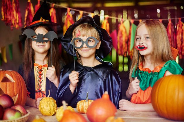 Stock photo of children dressed up for Halloween in imaginative costumes.