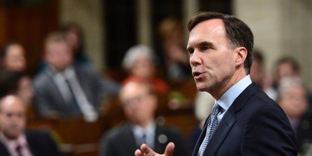 Finance Minister Bill Morneau stands during question period in the House of Commons on Oct. 23,