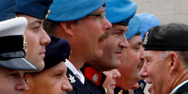 Chief of the National Defence Staff General Walter Natynczyk inspects the Honour Guard at the Peacekeeping...