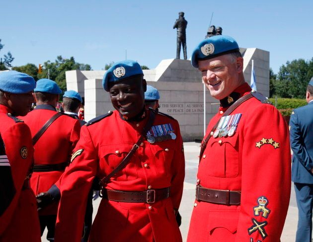 RCMP Cpl. Kofi Gordon, left, who served as a peacekeeper in the Democratic Republic of the Congo and...