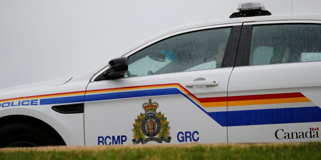 A RCMP officer sits in a vehicle in Ottawa on April 19,