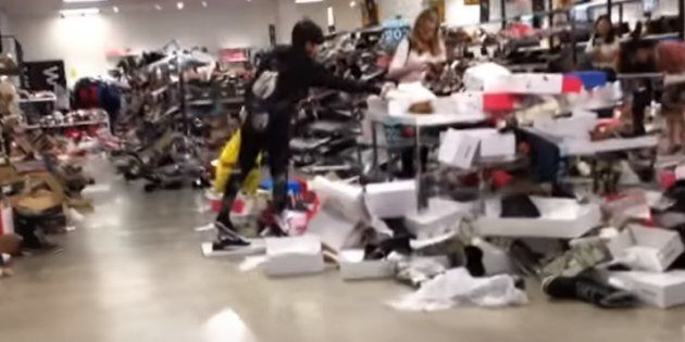 A screengrab from a YouTube video shows a chaotic scene at one of Sears Canada's stores during