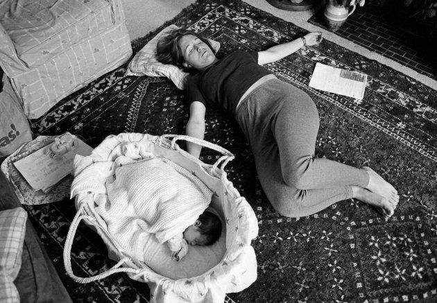 A young mother grabs a few minutes to exercise her pelvic floor muscles three weeks after giving birth. From a documentary series about the first year a child's life. (In Pictures Ltd./Corbis via Getty Images)