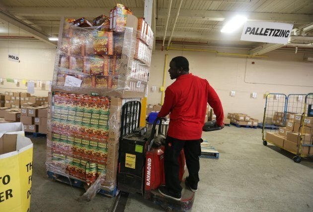 Volunteers from Target team members (employees) help sort and pack food items and more at the Daily Bread...