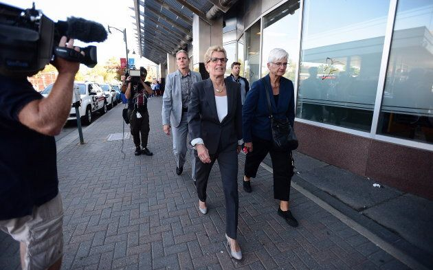 Ontario Premier Kathleen Wynne, accompanied by her partner Jane Rounthwaite, leaves after appearing as...