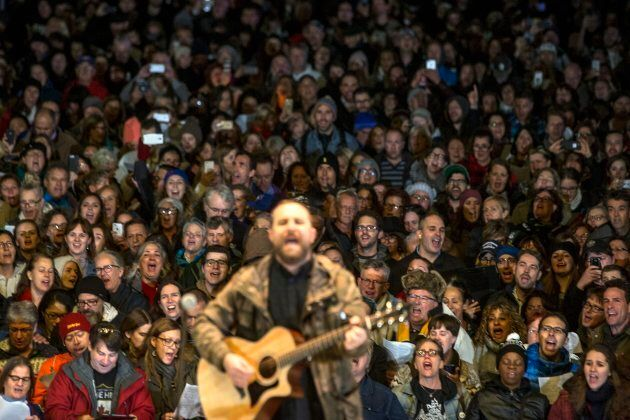 More than a thousand people gathered to sing about a dozen songs from The Tragically