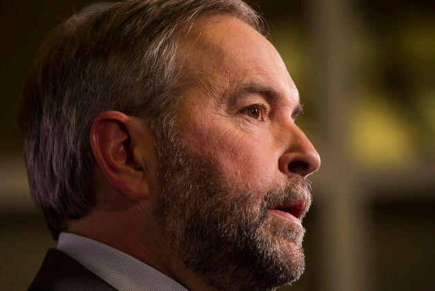 Thomas Mulcair speaks to media after a leaders' debate in Calgary during the 2015 federal