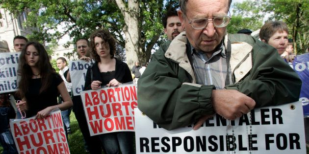Anti-abortion activists demonstrated outside Western University in London, Ont. to protest Dr. Henry...