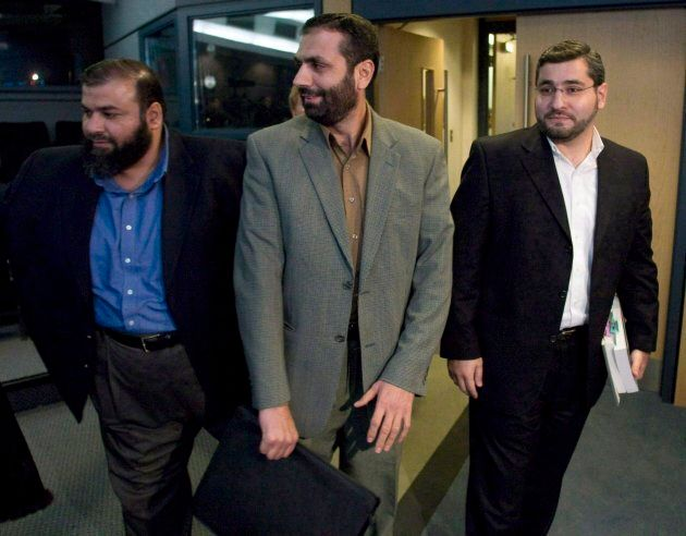Abdullah Almalki, right to left, Muayyed Nureddin and Ahmad El-Maati arrive at a news conference in Ottawa...