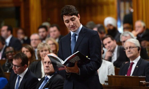 Prime Minister Justin Trudeau reads from his party's 2015 platform in the House of Commons on Oct. 18,