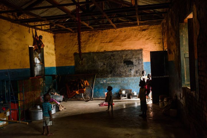 Children play in a classroom which families use as a shelter to sleep in at night, on the grounds of St. Mary's cathedral, which is host to thousands of internally displaced persons, Wau, Western Bahr el Ghazal, South Sudan, Thursday, June 15, 2017.