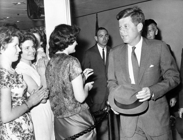 American President John F Kennedy chats with staff at the U.S. Embassy in London.