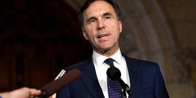 Finance Minister Bill Morneau speaks to reporters in the foyer of the House of Commons on Parliament...