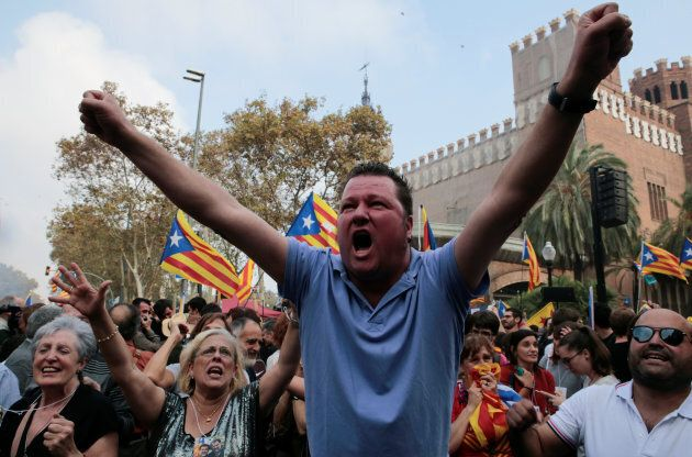 People celebrate after the Catalan regional parliament declares independence from Spain in Barcelona,...