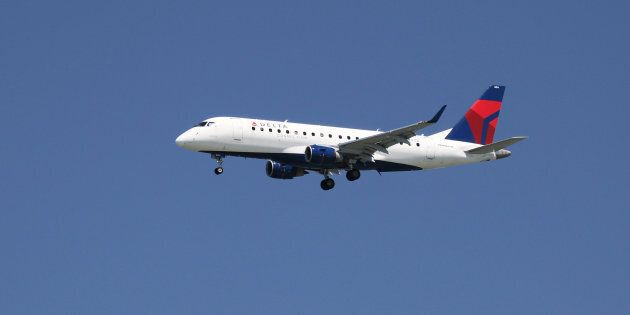 A Delta Airlines Embraer 175, with Tail Number N604CZ, lands at San Francisco International Airport,...