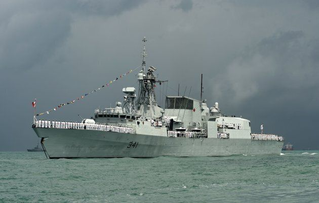 The HMCS Ottawa during the inaugural maritime review along the strait near Changi Naval Base in Singapore...