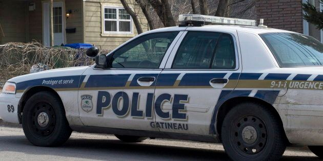 A police car parked in a residential area in Gatineau, Que. on April 10,